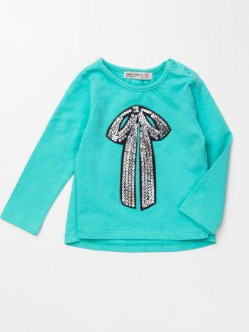 Miętowa bluzka dla dziewczynki z cekinową aplikacją