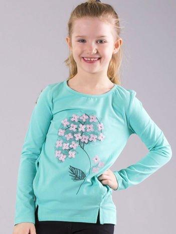 Miętowa bluzka dziewczęca z nadrukiem i kieszeniami