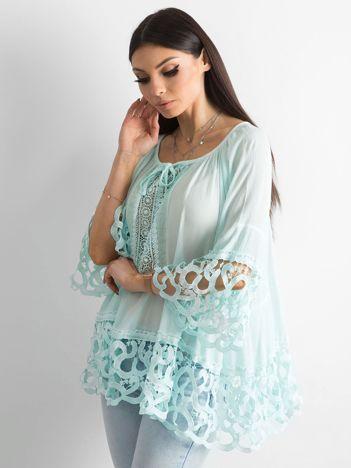 Miętowa bluzka koronkowa oversize