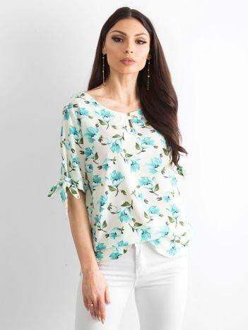 Miętowa bluzka w kolorowe kwiaty