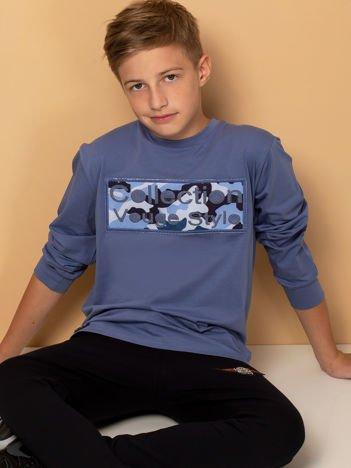 Niebieska bluza dla chłopca z naszywką