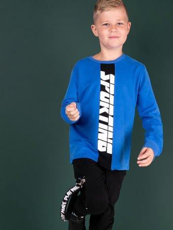 Niebieska bluzka dziecięca ze wstawką