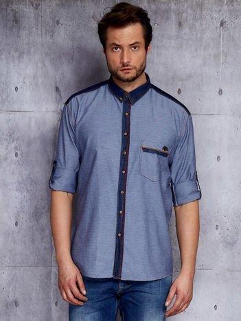 Niebieska koszula męska z przypinką na kieszonce