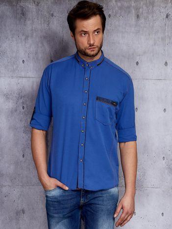Niebieska koszula męska z zamszowymi modułami