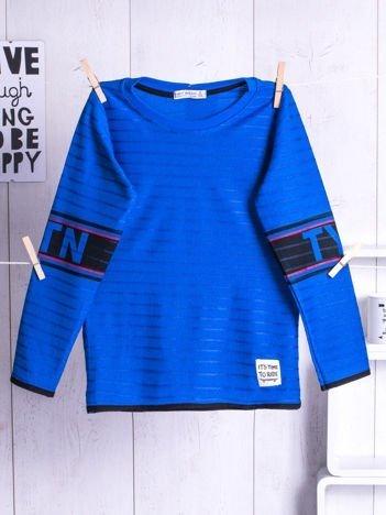Niebieski bluzka dziecięca z nadrukiem na rękawach