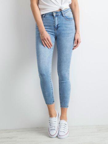 Niebieskie denimowe spodnie z suwakami