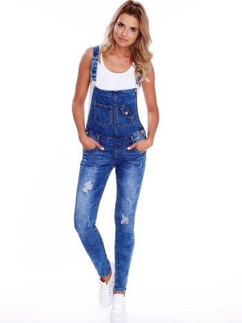 Niebieskie jeansowe ogrodniczki z przetarciami