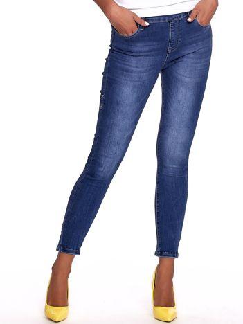 Niebieskie jeansy damskie slim fit z suwakiem z tyłu