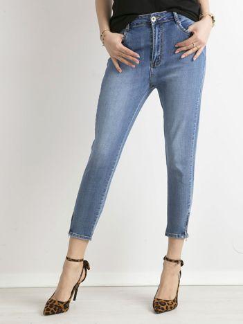 Niebieskie jeansy damskie z suwakami