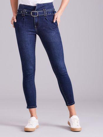 Niebieskie jeansy high waist z wiązaniem