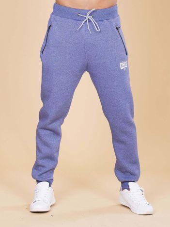 Niebieskie ocieplane spodnie dresowe męskie