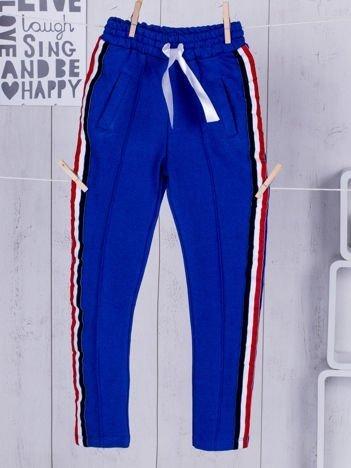 Niebieskie spodnie dresowe dla dziewczynki z wstążką
