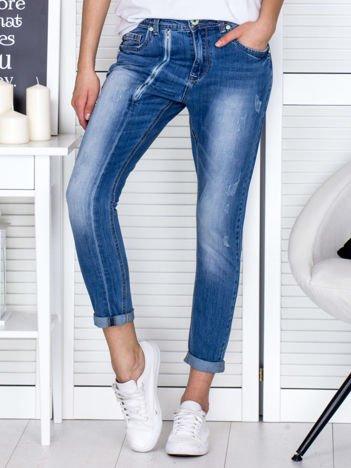 Niebieskie spodnie jeansowe damskie z ozdobnym suwakiem PLUS SIZE