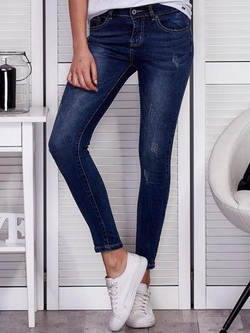 Niebieskie spodnie jeansowe skinny z przetarciami