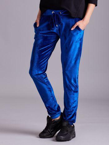 Niebieskie welurowe spodnie z troczkami