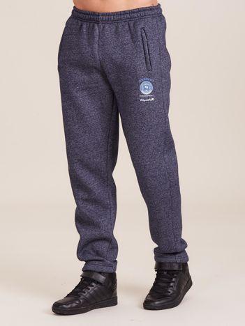 Ocieplane męskie spodnie dresowe granatowe