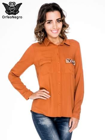 Pomarańczowa bluzka z biżuteryjną kieszonką