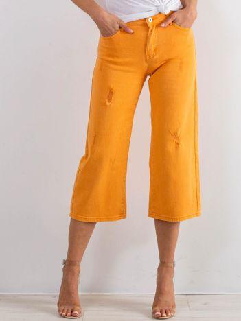 Pomarańczowe jeansy Reasons