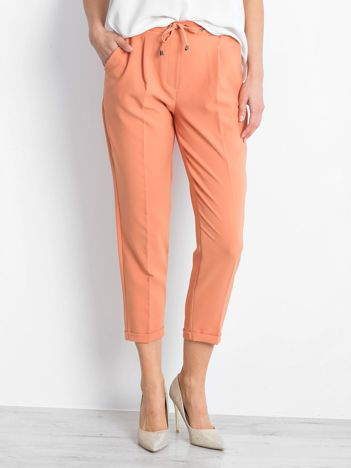 Pomarańczowe spodnie Arbitration