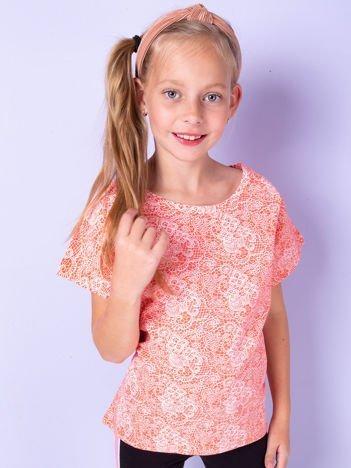Pomarańczowy t-shirt dla dziewczynki z kwiatowym nadrukiem