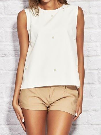 Rozkloszowana bluzka z perełkami biała
