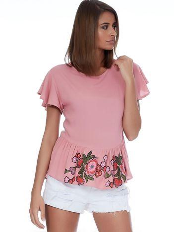 Różowa bluzka z nadrukiem na falbanie