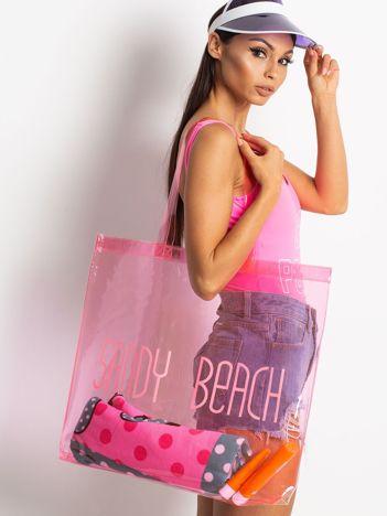 Różowa transparentna torba z napisem
