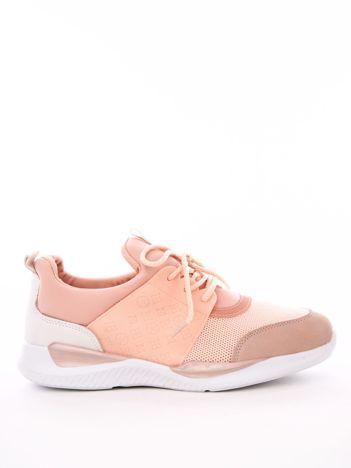 Różowe profilowe buty sportowe z gumowymi szlufkami i tłoczonymi wzorami