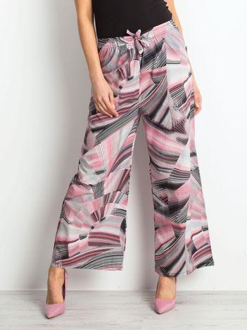Różowo-czarne spodnie Saying