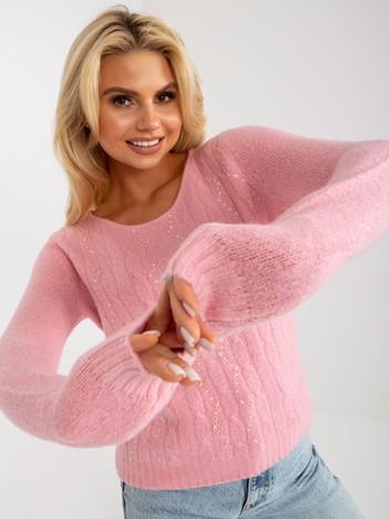 Różowy sweter w warkocze z cekinami