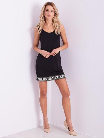 SCANDEZZA Czarna mini sukienka z ozdobnym dołem