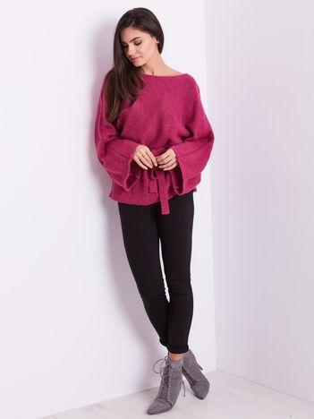 SCANDEZZA Różowy sweter z szerokimi rękawami