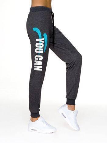 Spodnie damskie dresowe fitness z napisem grafitowe