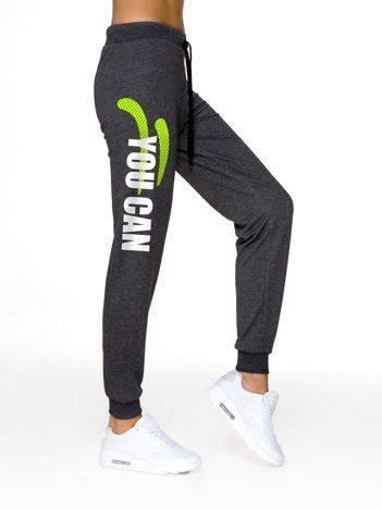 Spodnie dresowe fitness z nadrukiem grafitowe