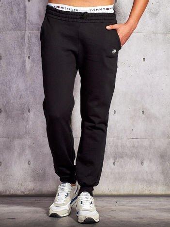 Spodnie dresowe męskie czarne ze ściągaczem