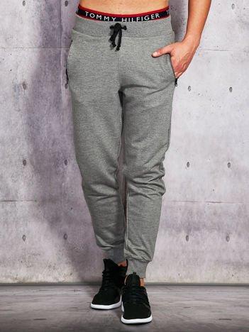 Spodnie dresowe męskie z kieszeniami na suwak szare