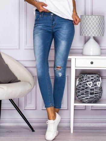 Spodnie jeansowe regular waist z dziurami niebieskie