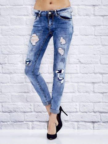 Spodnie jeansowe rurki ombre z dziurami niebieskie