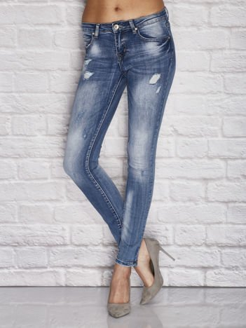 Spodnie jeansowe z przetarciami niebieskie