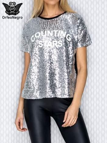 Srebrna bluza z cekinami i napisem COUNTING STARS