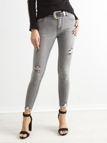 Szare jeansowe rurki z przedarciami