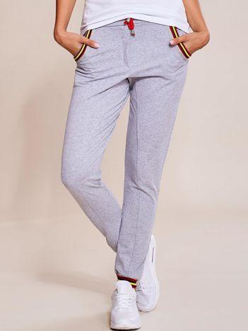 Szare spodnie dresowe damskie rurki z kolorowymi ściągaczami