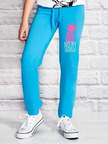Turkusowe spodnie dresowe dla dziewczynki NIEZŁY ANANAS