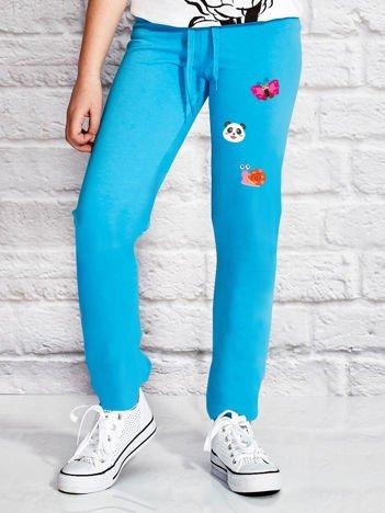 Turkusowe spodnie dresowe dla dziewczynki ze zwierzątkami