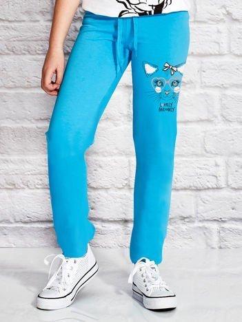 Turkusowe spodnie dresowe z dziewczęcym nadrukiem