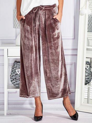 Welurowe spodnie flare z troczkami brązowe