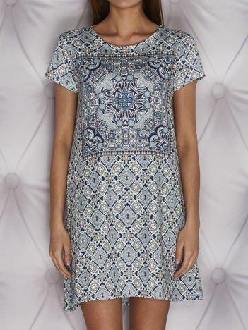 Wzorzysta sukienka dzienna o kroju litery A turkusowa