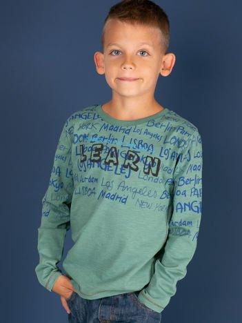 Zielona bluzka dziecięca z tekstowym nadrukiem