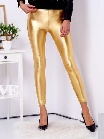 Złote błyszczące legginsy