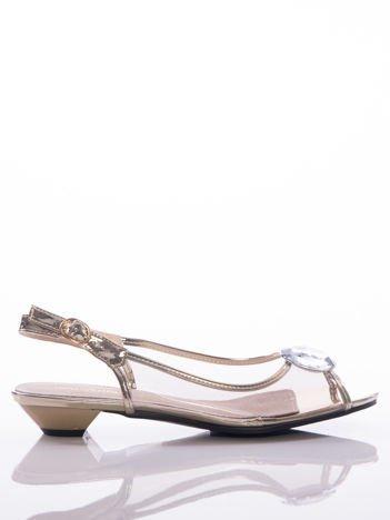 Złote sandały Sabatina z przezroczystą cholewką i ozdobnymi kryształkami na przodzie
